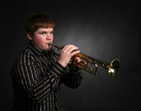 Teenage boy playing trumpet Royalty Free Stock Photo