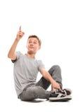 Teenage boy points up Royalty Free Stock Photo