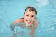 Teenage boy in pool Royalty Free Stock Photos