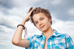 Teenage Boy. Portrait of a charming and happy teenage Boy outside against cloudy sky Stock Images