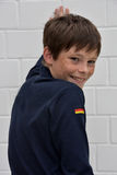Teenage boy. Portrait of a cute teenager boy with a lot of freckles and the german flag on his dshirt Royalty Free Stock Image