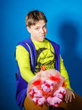 Teenage boy posing with bouquet of flowers Royalty Free Stock Photography