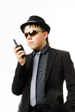 Teenage boy posing like a guardsman with radio transmitter Royalty Free Stock Photography