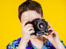 Teenage boy posing with photo camera Royalty Free Stock Photos