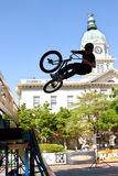 Teenage Boy Practices Ramp Jumps At BMX Competition Stock Photo