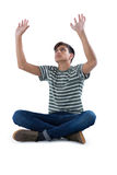 Teenage boy praying against white background Stock Photography