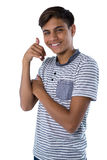 Teenage boy pretending to talk on a cell phone. Portrait of teenage boy pretending to talk on a cell phone Stock Image