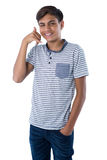 Teenage boy pretending to talk on a cell phone. Portrait of teenage boy pretending to talk on a cell phone Royalty Free Stock Image