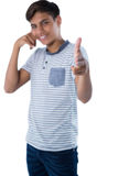 Teenage boy pretending to talk on a cell phone. Portrait of teenage boy pretending to talk on a cell phone Royalty Free Stock Photo