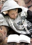 Teenage boy reading stock photos