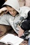 Teenage boy reading Royalty Free Stock Images