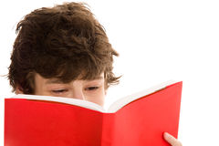 Teenage boy reading book Royalty Free Stock Photography