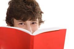 Teenage boy reading a book royalty free stock photos