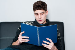 Teenage boy reading a book Royalty Free Stock Image
