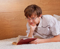 Teenage boy reading a book Stock Image