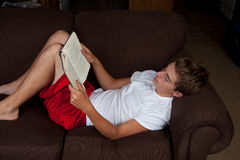 Teenage Boy Reading Royalty Free Stock Photography
