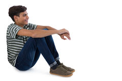 Teenage boy relaxing. Against white background Royalty Free Stock Photos