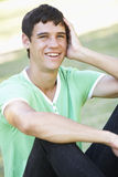 Teenage Boy Relaxing In Park Stock Photography