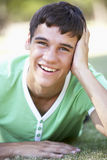 Teenage Boy Relaxing In Park Stock Photo
