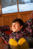 Teenage Boy Relaxing On Sofa Royalty Free Stock Image