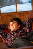 Teenage Boy Relaxing On Sofa Stock Photo