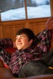 Teenage Boy Relaxing On Sofa Stock Photo