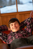 Teenage Boy Relaxing On Sofa Royalty Free Stock Photo
