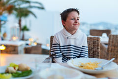 Teenage boy at restaurant Stock Image