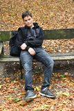 Boy resting on a bench royalty free stock photo