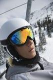 Teenage boy riding chair lift at ski resort. Royalty Free Stock Photos