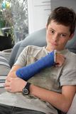 Teenage boy with right arm in plaster royalty free stock images