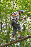 Teenage boy at the rope parkour stock images