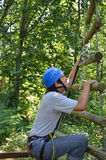 Teenage boy at the ropes course Royalty Free Stock Image
