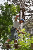 Teenage boy at the ropes course Stock Photos