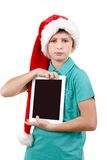 Teenage boy with santa claus hat Stock Photography
