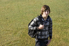 Teenage boy with school backpack Royalty Free Stock Photos
