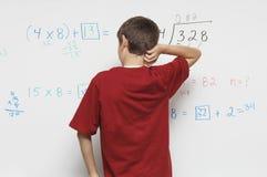 Teenage Boy Scratching Head Stock Image