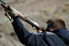 Teenage Boy Shooting. Sporting clays Royalty Free Stock Photography
