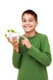 Teenage boy showing piggy money box Stock Photos