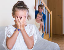 Teenage boy with sisters playing hide-and-go-seek Stock Images