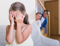 Teenage boy with sisters playing hide-and-go-seek Stock Photo