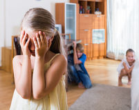 Teenage boy with sisters playing hide-and-go-seek. Teenage boy with little sisters playing hide-and-go-seek indoors Royalty Free Stock Photos