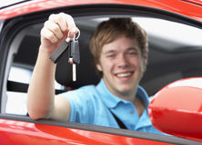 Teenage Boy Sitting In Car Holding Car Keys Royalty Free Stock Image