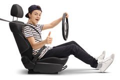 Teenage boy sitting in car seat and giving thumb up Royalty Free Stock Photography