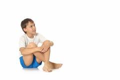 Teenage boy sitting isolated Stock Photos
