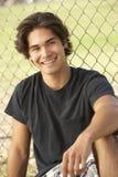Teenage Boy Sitting In Playground Royalty Free Stock Image