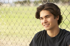 Teenage Boy Sitting In Playground Stock Photos