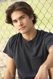 Teenage Boy Sitting In Playground Stock Photography