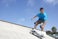 Teenage Boy In Skateboard Park Stock Photo