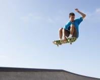 Teenage Boy In Skateboard Park. In air Stock Photos